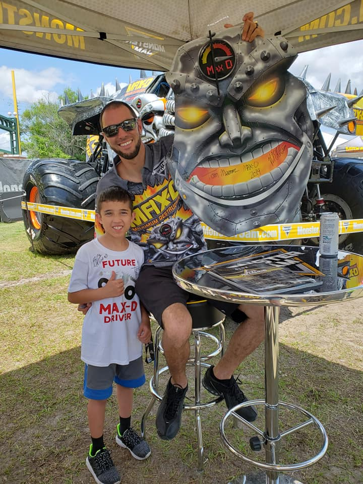 Evan with Blake Granger getting his Max-D fiberglass signed by each of the Max-D drivers May 2019 Orlando FL
